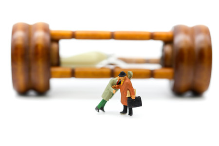 Miniature people : Businessman about to stab his friend,business concept.