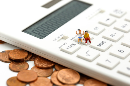 Miniature people : Couple children  standing with Calculator,business,tax concept.