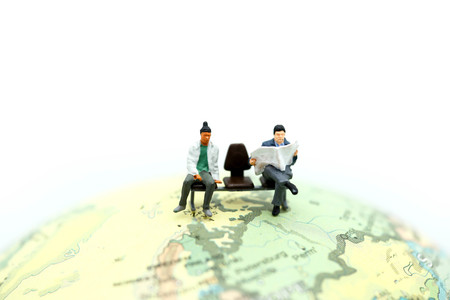 Miniature people : traveler  with world map, backpack and travel concept.