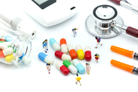 Miniature people : children stand with drug,pills,capsules Healthy and medicine concept.