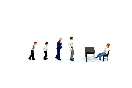 Miniature people : businessman walking and waiting to interview with Human Resource Manager,Finding new job and Opportunity, HR background concept.