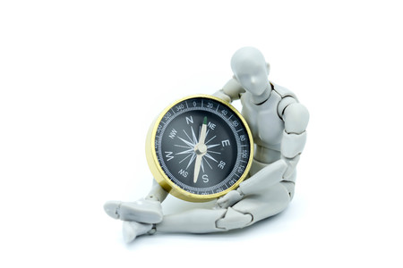 Model robot with compass,business and travel concept. Reklamní fotografie