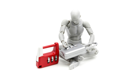 Model robot with metal key. Stock Photo