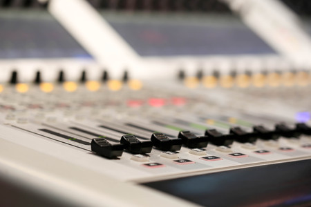 Professional audio Mixer and Professional Headphones in the Recording Studio. Sound Mixing Desk. Sound Mastering For Radio and TV Broadcast.