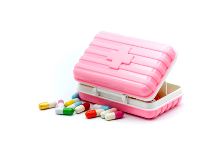 Piill capsules , Pill Box for polypharmacy patients,Large pill box for individual weekly pill storage Stock Photo