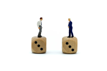 Miniature people : young businessman standing on dice,Gambling and casino business concept.