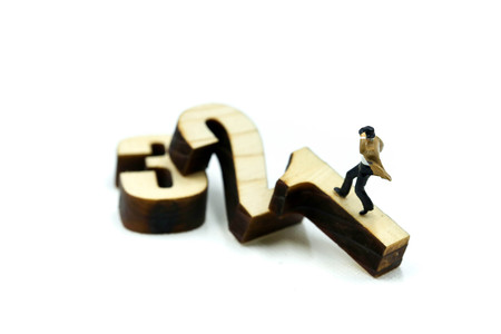 Miniature people : Businessman with wooden number of 1,2,3 , to be the first,business competition concept.