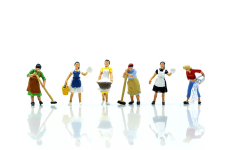 Miniature people : Maid or Housewife cleaning on white background. Reklamní fotografie