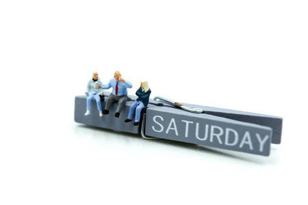 Miniature people : people feeling and sitting on list of saturday.