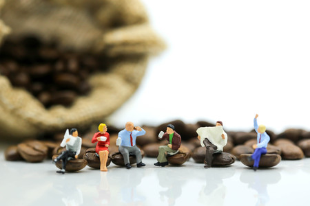 Miniature people : business team sitting on coffee beans,relax concept.