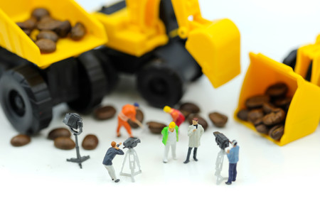 Miniature people : journalist making an interview a professional construction engineer ,industrial engineering and production television concept.