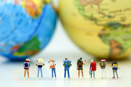 Miniature people : Travelers with world globe and airplane , traveling or exploring the world, budget travel concepts.