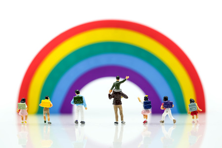 Miniature people : children and student playground in city park with rainbow background,Education,Play and learn concept.