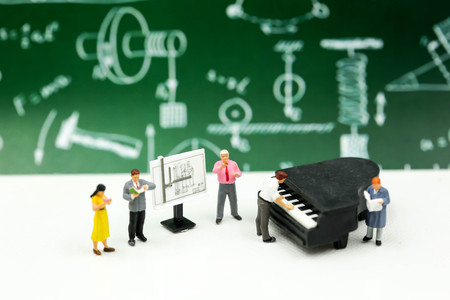 Miniature people : Teacher and student with piano class of music. Stock fotó