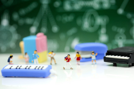 Miniature people : Teacher and students , children with School supplies and piano , Back to school concept. Stock Photo