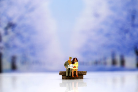 Miniature people : Couple of love with snow winter background,Lover concept. Stock Photo