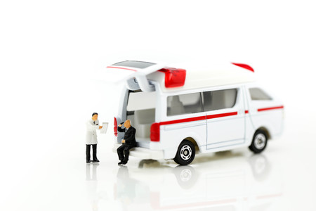 Miniature people : Doctor and Paramedic attending to patient in ambulance,Medicine ambulance concept Stok Fotoğraf