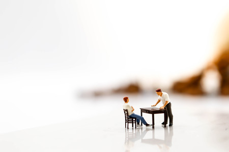 Miniature people : angry businesspeople quarreling,Conflict and business concept Stock Photo