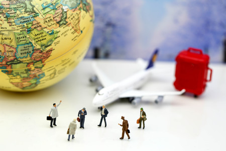 Miniature people : Businessman with airplane,worldmap,luggage of snow winter background.Business Travel concept. Stock Photo