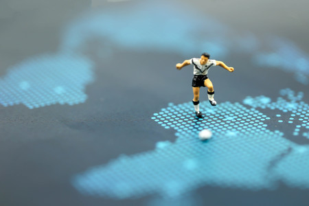 Miniature people : Soccer player man,football world championship cup concept. Stock Photo