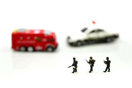 Miniature people : Soldier team with fire engine and police car.