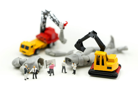 Miniature people : Businessman and Engineer deal production robots,industry  Robot Business concept.