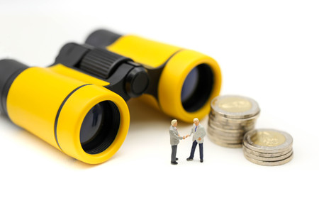 Miniature people : Businessman standing with binoculars,Choice of the best suited employee, HR, HRM, HRD, job recruiter concepts.