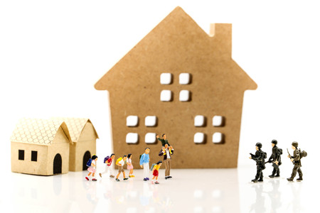 Miniature people : Soldier go home after mission complete with children and family,coming home concept. Stock Photo