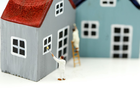 Miniature people : Workers painting a  Mini house, art, money, finance, business concept. 版權商用圖片