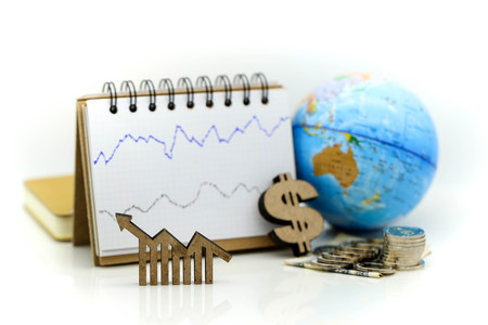 Stock market or forex trading graph and candlestick chart with money and world map,financial investment concept. Stock Photo