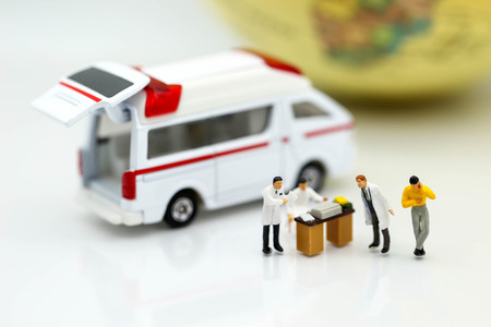 Miniature people : Doctor and patient with ambulance using for concept of Emergency Nurses Day Stok Fotoğraf