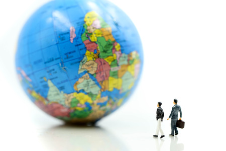 Miniature people : Businessman standing with Global World map balloon,Success Business Due around the world and Strategy Planning concepts. Stock fotó - 110260521