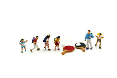 Miniature people : Student and children's playing a game of table tennis or ping-pong,Education Sport concept.