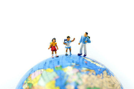 Miniature people : Student and childrens standing with Mini world using for concept of Universal Childrens Day. Stock Photo
