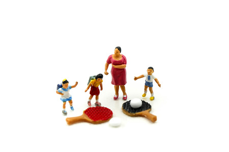 Miniature people : Student and children's playing a game of table tennis, Education Sport concept.