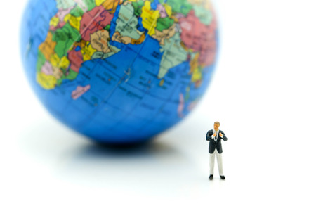 Miniature people : Businessman with mini world using for concept of International Men's Day. Archivio Fotografico