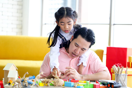 Parent and little child having fun playing educational toys,Family concept.