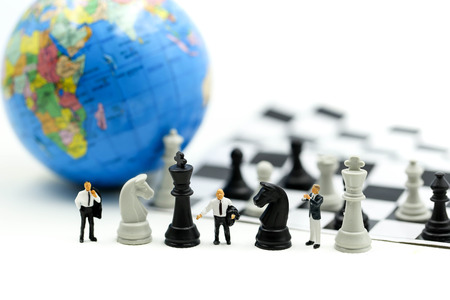 Miniature people : business team strategy training with chess,target, decision and competition concept. Stockfoto