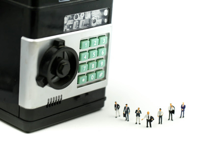 Miniature people : Businessman with investment concept bank building