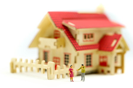 Miniature people : Couple of love with house,Concept for property ladder, mortgage,real estate investment, money
