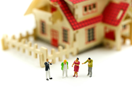 Miniature people : meet with realtor or broker talking about home purchase,taking loan for first apartment, family counselling.