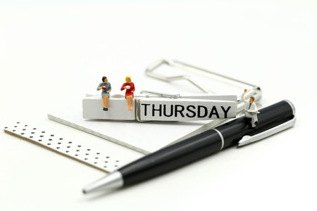 Miniature people : businessman and friend with Word Thank you on Thursday 27th,using for concept of Thank you Thursday.