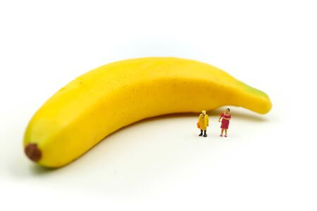 Miniature people : worker with banana using for banana Day Archivio Fotografico - 131871048