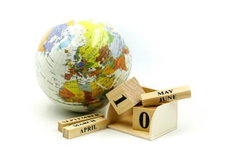 Wooden block calendar date and month with mini world. Reklamní fotografie