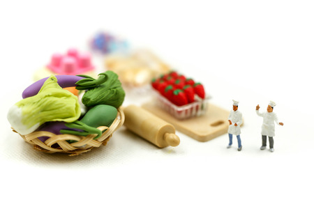 Miniature people : Chef with Assortment of fresh fruits and vegetables, cooking concept. 写真素材