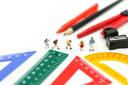 Miniature people : teacher and student with Group of stationery tools Educational tools supplies back to school concept. 写真素材
