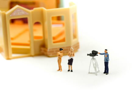 Miniature people : Cameraman and photographer trying to take a photo with beautiful nude topless breasts, Nude concept.