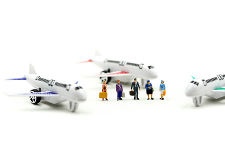 Miniature people : with airplane ,Transportation, traveling or business trip concepts.