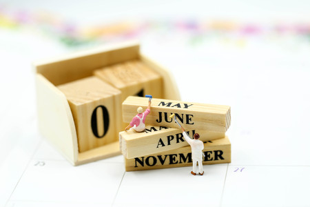 Miniature people : Wooden block calendar date and mounth with miniworld.