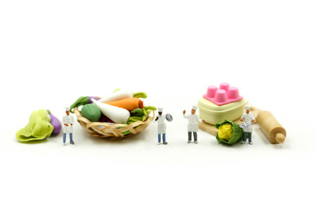 Miniature people : Chef with Assortment of fresh fruits and vegetables,cooking concept.